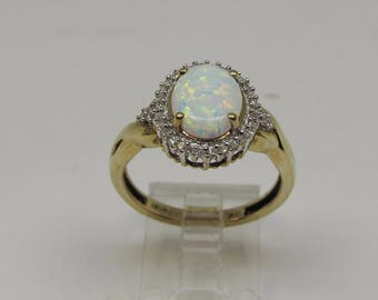 Opal and Diamond Oval Cluster Ring
