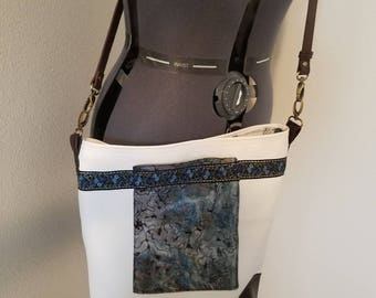 Large cross body faux leather tote