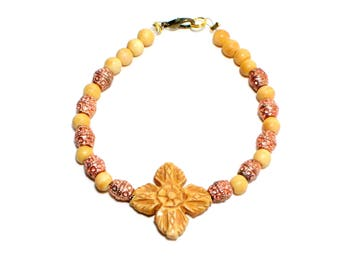 Bohemian carved bone flower and copper beaded stackable bracelet