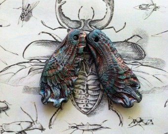237. Wings of a Dove Two  Blue  Gold Rust Raku Wing Pendants