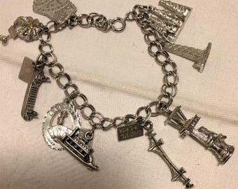 Vintage Sterling 7 Inch Travel Charm Bracelet Mississippi, Hawaii, Michigan (3), Las Vegas, Madison, and 2 Without Identification. (D15)