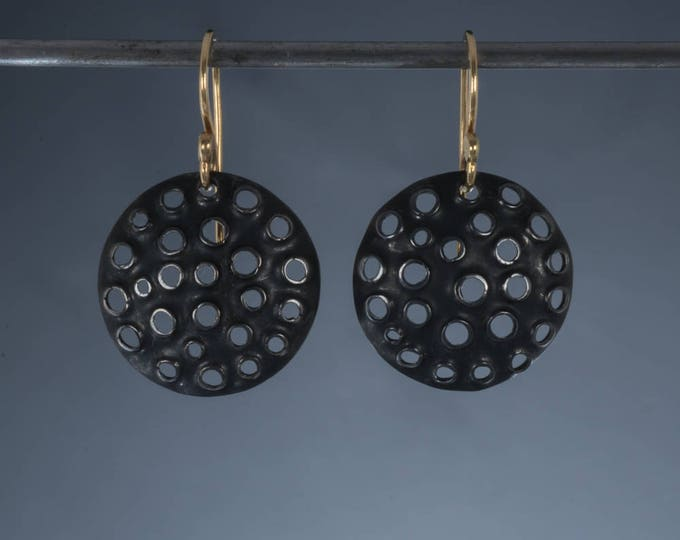 Perforated sterling silver earrings round oxidized 15mm with 18k gold hooks.