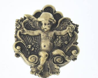 Brass stamping Cherub in a rose or flower , concave on back, sold by each 04248AG