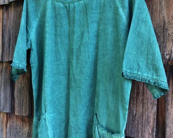 A People United forest green linen blouse with ruffled hem and cuffs