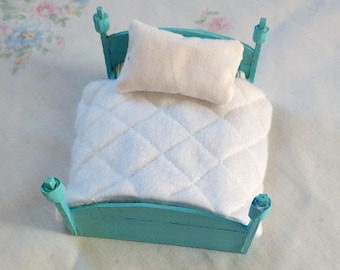 Teal wooden dollhouse bed with furnishings, 1:24 scale