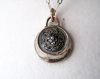 Vintage filigree set in hand hammered US quarter pendant featuring turquoise shards and Oklahoma red dirt
