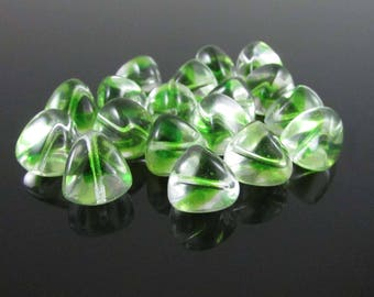 "12 x 11mm green & clear glass trigons, 8"" strand (18 beads)"