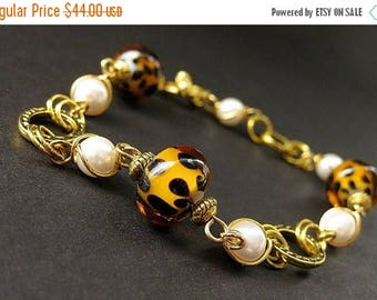 SUMMER SALE Lampwork Glass Leopard Print Bracelet in Gold and Pearls. Handmade Bracelet.