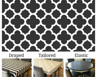 """For Sara Laminated cotton aka oilcloth tablecloth tailored for 34.25"""" x 61"""" table, 2.5"""" drop all around, white mosaic on black Quatrefoil"""