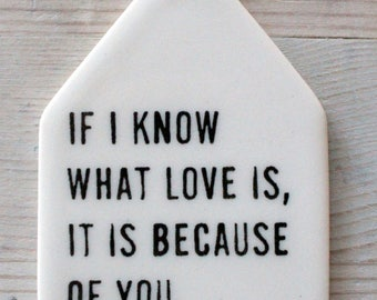 porcelain wall tag screenprinted text if i know what love is, it is because of you. -hesse