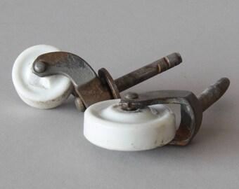Two Vintage Porcelain Stem Casters
