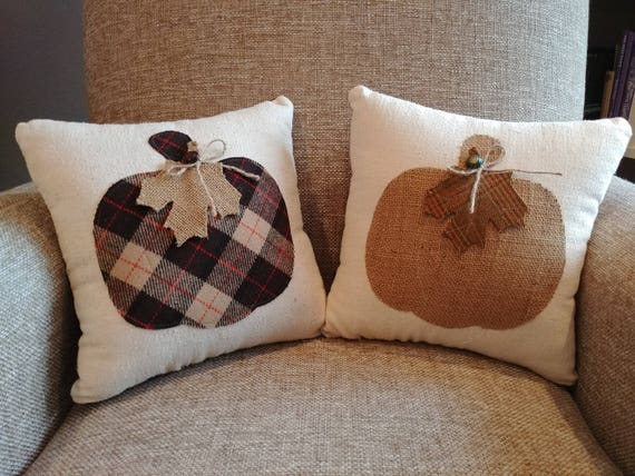 Pair of decorative pillows with pumpkins