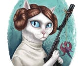 """SALE Princess Leia Cat - 8 x 10"""" print of a white cat holding a blaster with a cat toy"""