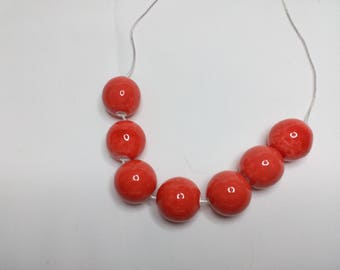 Tangerine beaded necklace on Sterling chain