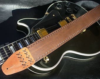 Handmade brown leather guitar strap. Hand tooled. Made in Italy.