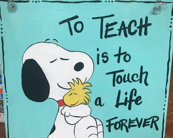 Snoopy teacher sign To teach is to touch a life forever