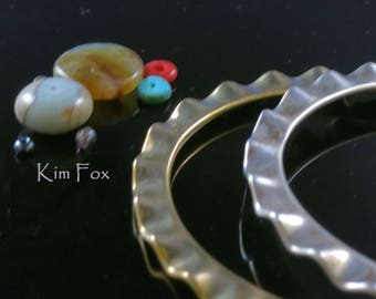 8 inch Oval Shaped Wave Edge Bangle in Sterling Silver designed by Kim Fox