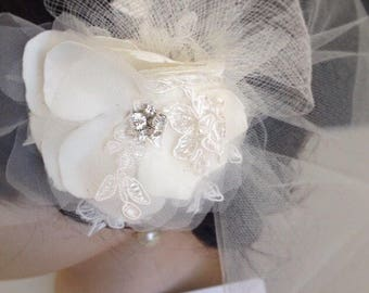The Albie ivory lace flower headpiece and tulle veil