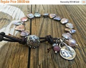 ON SALE Mauve Cornflake Pearl Bracelet, Artisan Pure Silver Components, Artisan Button Closure, Relic Pegasus Charm, Ruby Pearl dangle