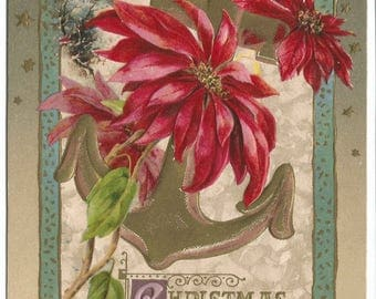 Bright Ruby Red Poinsettia Intertwined with Gold Anchor Snow Covered Cottage Scene in Background Vintage Postcard Christmas Greeting Card