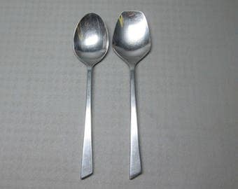 Stanley Roberts stainless steel flatware CARIF , a serving spoon and a flat ended serving spoon CARIFJUM