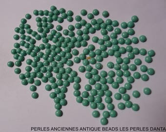 220 antique beads  in pressed glass