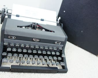 1940's Royal Quiet De Luxe Glass Keys Portable Mechanical Typewriter with original case. Made in the U.S.A.
