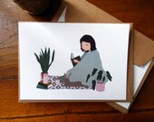 """Carte postale """"Sous le plaid"""", série """"Un lapin à la maison"""""""