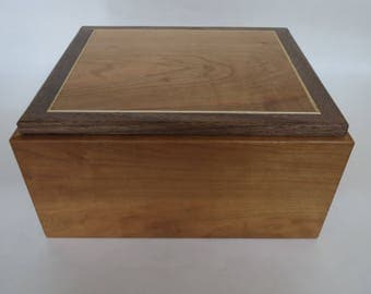 Wooden box from cherry, walnut and ash