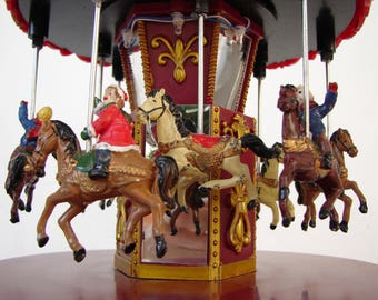 Vintage,plastic  Christmas carousel , merry go round, children on horses fairground ride,lights up  & revolves