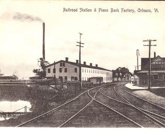 Vintage Postcard....Vermont, Orleans, Railroad Station & Piano Back Factory....Used, 1910...no. VT0058