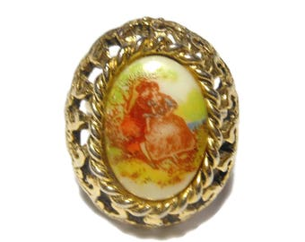 Transferware ring, adjustable ring, hand painted couple in idyllic setting, oval ceramic cabochon inside gold ornate frame, gold plated