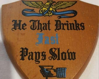 "Enesco Vintage Wooden Plaque, ""He That Drinks Fast Pays Slow"""