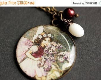 BACK to SCHOOL SALE Smiling Fairy Necklace. Purple Fairy Pendant with White Coral Teardrop and Pearl. Charm Necklace. Purple Necklace. Bronz