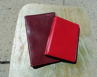 Two small vinyl notebooks with paper