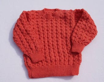 Baby girls jumper hand knitted in deep pink with all over textured pattern to fit 12 - 18 months