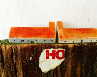 2 tiny houses on a painted cliff, mix media wall decoration, 3d painting, sculpture