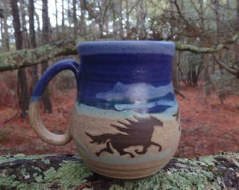 The wild horses of Corolla gallop around the outside of this large coffee mug