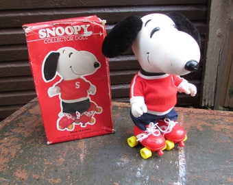 Vintage Snoopy Doll. Rubber Snoopy with Clothes and Roller Skates.  Determined Productions, Inc., San Francisco, CA  IOB. Nice Condition.