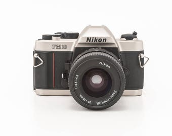 Nikon FM10 35mm film camera with 35-70mm Nikon lens and fitted case  - great condition - great student camera