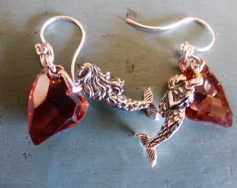 Mermaids Have Hearts Too Earrings - sterling silver mermaids holding on to their Swarovski Elements crystal hearts, swimming on your ears.