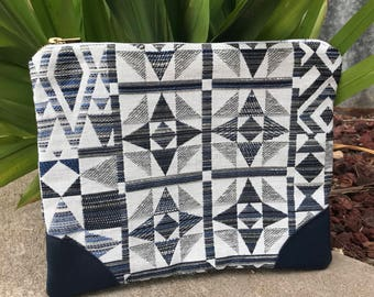 Navy clutch with leather corners