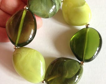 Bracelet -  in sage green and lime green marbled and transparent plastic pebble shaped bead bracelet retro design