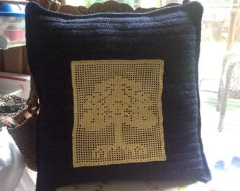 Blue pillow with tree, crochet