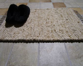 ALPACA Bath Mat, Unique Creme With Splashes of Fawn With Taupe Woven Ends And Fringe.  Useful - Sheds Water Very Well so it Dries Fast.