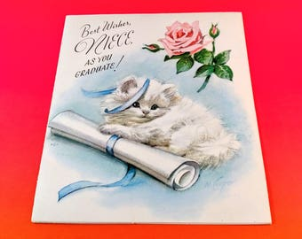 """1950's Marjorie Cooper Graduation Card. """"Best Wishes Niece as You Graduate"""" with White Kitten and  Pink Rose. Mid Century Ephemera."""