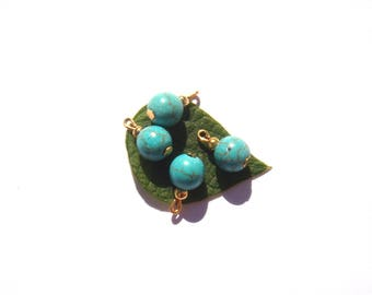 Turquoise dyed Howlite: 4 small charms 15 mm tall x 8 mm in diameter