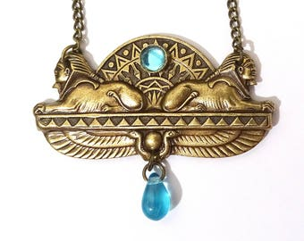 Egyptian Necklace with sphynx oxidyzed brass and blue glass cabochon