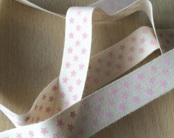 "decorative Ribbon: ""pink stars"" on an ecru background"