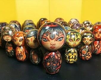 Hand-decorated dark Japanese Kokeshi Dolls
